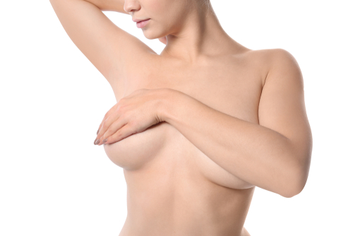 woman covering both breasts