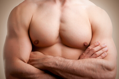 close up of a muscular male torso, arms crossed-img-blog
