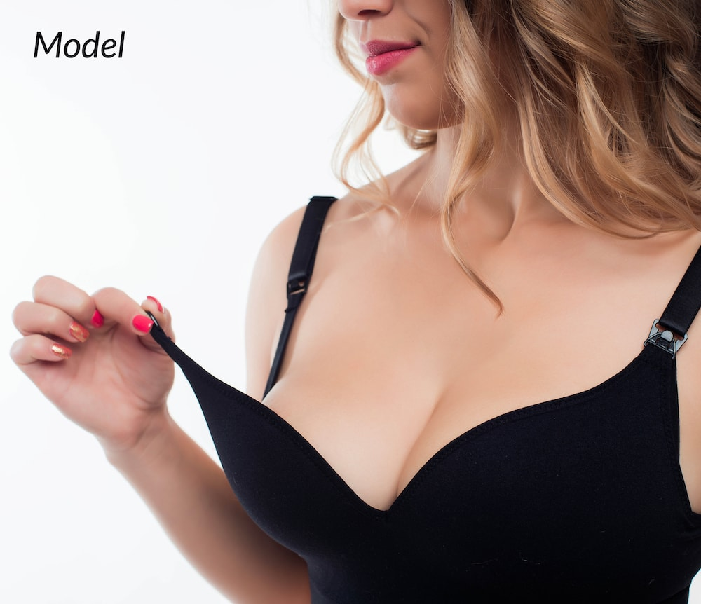 A woman considering breast reduction surgery to relieve physical comfort.