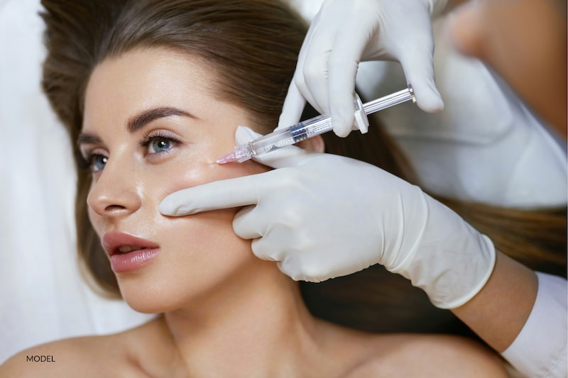 Woman getting injectable filler treatment in cheek